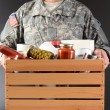 图库照片: Soldier Holding Food Drive Box