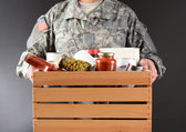 Soldier Holding Food Drive Box — Stock Photo