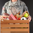 Soldier Holding Toy Drive Box — Stock Photo
