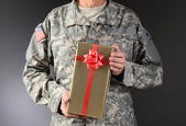 Soldier Holding Christmas Present — Stock Photo