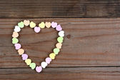 Candy Hearts Arranged in Heart Shape — Stock Photo
