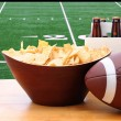 Chips, football and Six Pack of Beer and TV — Stock Photo #39290797