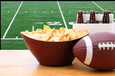 Chips, football and Six Pack of Beer and TV — Stock Photo