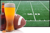 Glass of Beer and American Football — Stock Photo