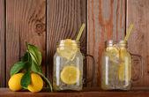 Lemonade Glasses on Shelf with Lemons — Stock Photo