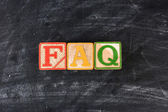 Childrens Blocks Spelling Out FAQ — Stock Photo