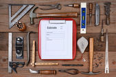 Contractors Estimate Form Surrounded By Tools — Stock Photo