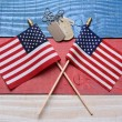 Two Flags and Dog Tags on Patriotic Table — Stock Photo #47741963