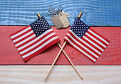Two Flags and Dog Tags on Patriotic Table — Stock Photo