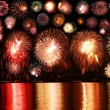 Stock Photo: Colorful fireworks reflect from water