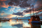 Boats and sunset — Stock Photo