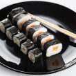 Sushi rolls on black dish — 图库照片