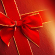 Gift box with red ribbon — Stock Photo #40383531