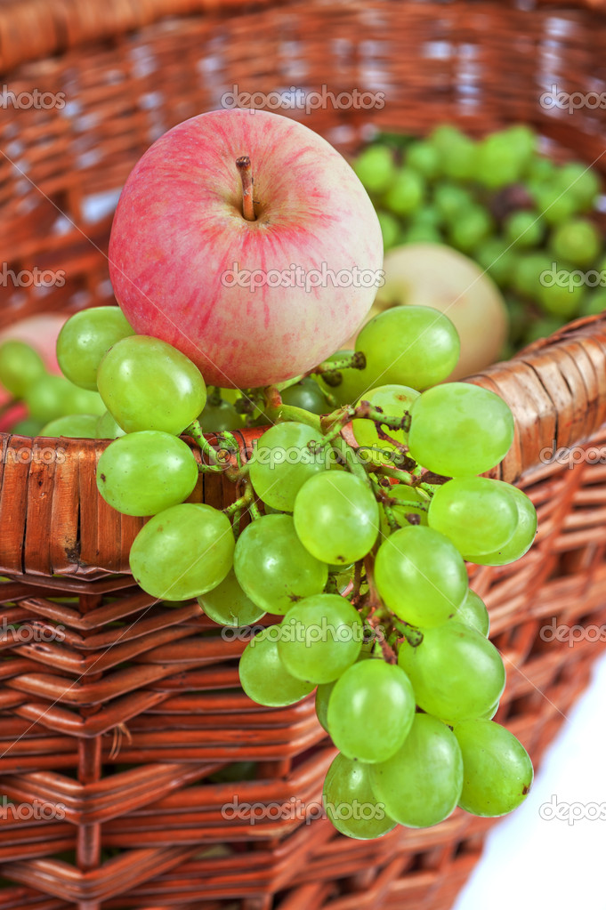 Apples and grapes in a basket just harvest — Stock Photo #13091635