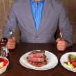 Eat a beef steak — Stock Photo #13775200
