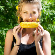 Royalty-Free Stock Photo: Woman eating corn-cob
