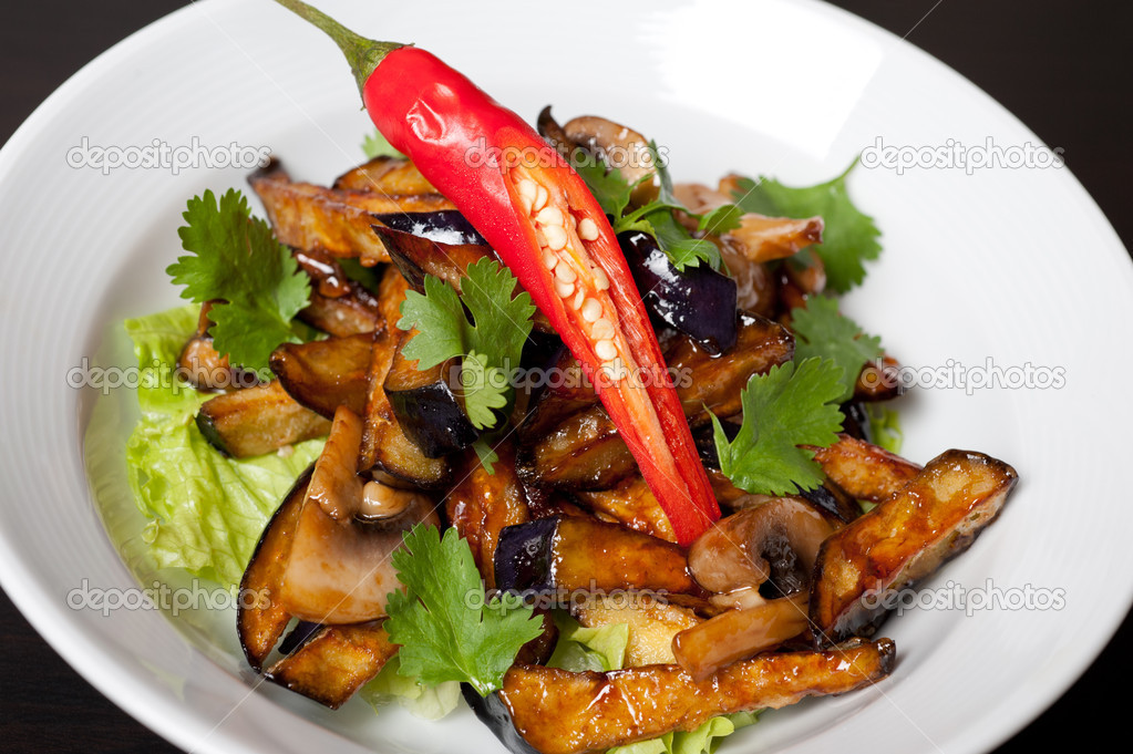 Salad from roasted eggplants, mushrooms, soy sauce, oyster sauce, cilantro and garlic  Stock Photo #14962211
