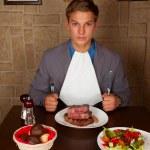 Eat a beef steak — Stock Photo #15358495