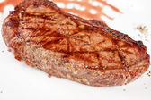 Juicy rib-eye beef steak — Stock Photo