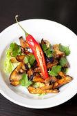 Salad from roasted eggplants — Stock Photo