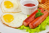 Fried eggs with sausages — Stock Photo