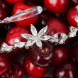 Jewels at cherries — Stock Photo