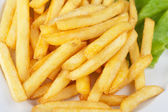 Golden potatoes fries — Stock Photo