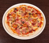 Pizza with ham and mushrooms — Stock Photo