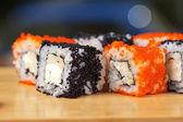 Rotolini di sushi tobico — Foto Stock