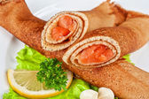 Pancakes with salmon — Stock Photo