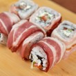 Sushi roll with bacon — Stock Photo