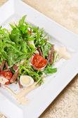 Tasty salad of beef tongue — Stock Photo
