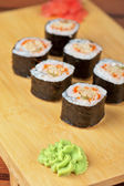 Sushi rolls with tobico and pancake — Stock Photo