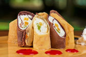Pancake roll with marmalade — Stock Photo