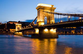 The Chain Bridge in Budapest lit by the street lights — Stock Photo