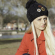 Beautiful blonde outdoors in coat and hat — Stock Photo #16531871