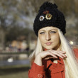 Beautiful blonde outdoors in coat and hat — Stock Photo #16532173