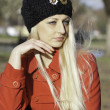 Beautiful blonde outdoors in coat and hat — Stock Photo #16533231