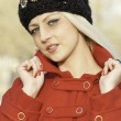 Beautiful blonde outdoors in coat and hat — Stock Photo #16534421