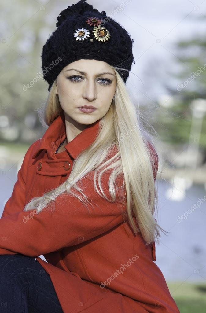 Beautiful blonde outdoors in coat and hat — Stock Photo #16533901