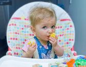 Baby girl eating — Stock Photo