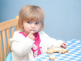 Baby eating bread and butter — Stock Photo