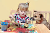 Two year old girl painting — Stock Photo