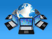 Computadores portáteis ao redor do globo do mundo — Fotografia Stock