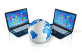 Laptop Computers around World Globe — Stockfoto