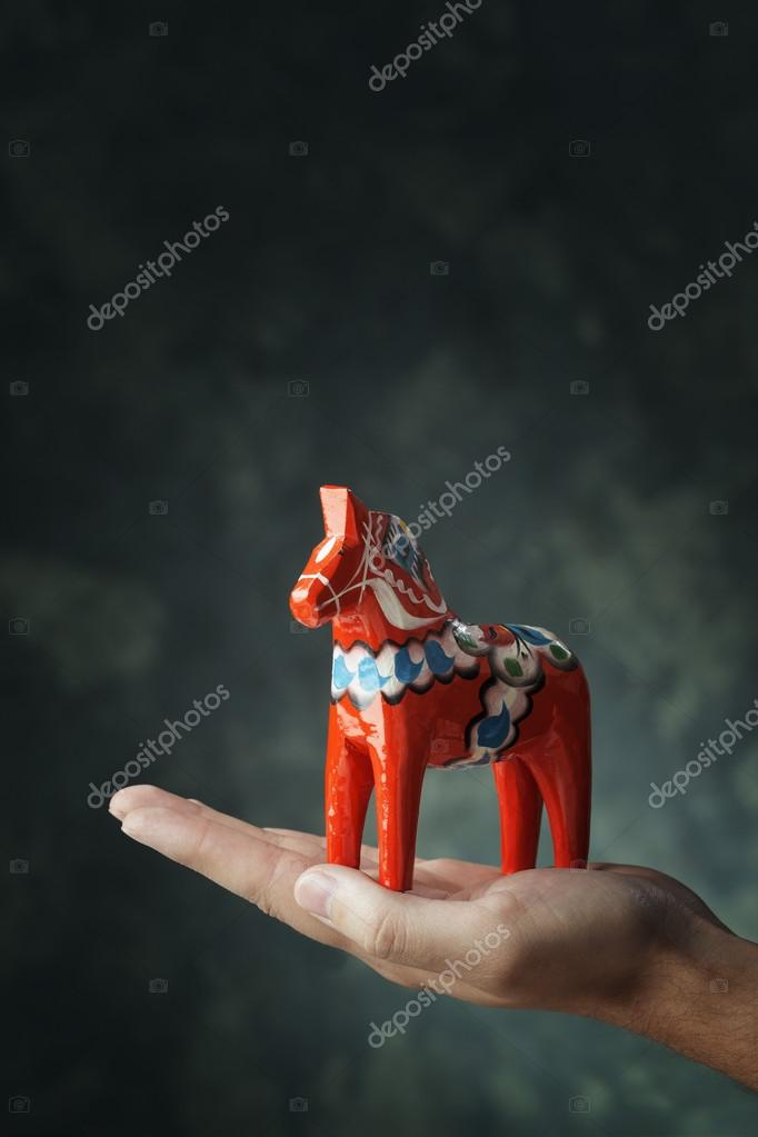Dalecarlian horse or Dala horse (Swedish: Dalahäst) is a traditional carved and painted wooden statuette, it has become a symbol of Dalarna as well as Sweden in gene — Stock Photo #12493187