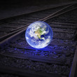 Stock Photo: Earth on rails