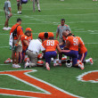 Stock Photo: Clemson football players and coaches praying before football game