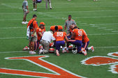 Clemson football players and coaches praying before football game — Stock Photo