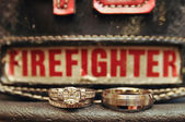 Wedding Rings on a Firefighters Hat — Foto de Stock